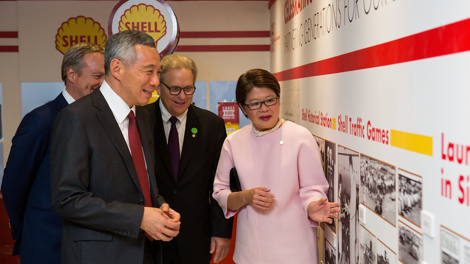 Goh Swee Chen, Chairperson of Shell Companies in Singapore, points out old articles about Shell to PM Lee