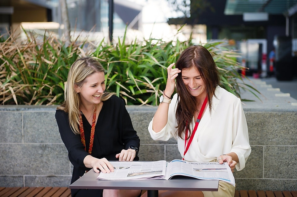 From right - Shell Graduate Samantha Palmer with her mentor Elise-Anne Muir having a conversation at a park