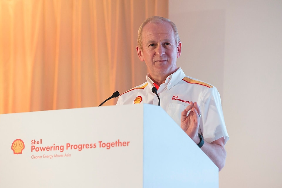 Shell's Downstream Director John Abbott standing on a podium and speaking over the mic